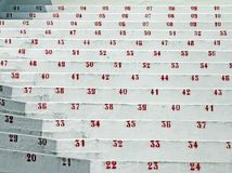 Red numbers in the stands of the stadium of football Stock Image