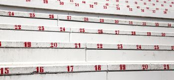 Red numbers in the stands of the stadium of football Royalty Free Stock Photos
