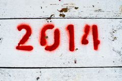 Red numbers 2014 on white surface Royalty Free Stock Photos