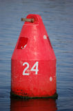 Red Nun. A red nun sits in the Peace River warning boaters of the channel boundaries stock photography