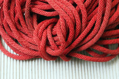 Red Nylon rope texture background on white napery Royalty Free Stock Images