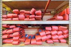 Red nylon soft lifting slings stacked in piles. Warehouse of finished products for industrial enterprises Royalty Free Stock Images