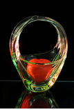 A gift for the beloved. The red object like a heart in a vase isolated on a dark background Stock Photo