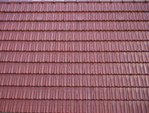Red oblong roofing tiles. Royalty Free Stock Photos