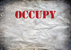 Red Occupy letters on a paper background Royalty Free Stock Photo