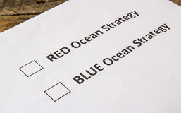 Red ocean and blue ocean strategy check boxes Royalty Free Stock Photo