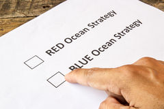 Red ocean and blue ocean strategy check boxes Stock Photo