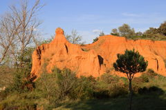 Red ochre lands or ocher lands in Pyrenees , France Stock Photo