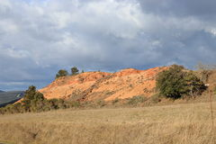 Red ochre lands or ocher marl in Corbieres, France Royalty Free Stock Photo