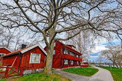 Red ochre painted colour wooden houses Stock Photos