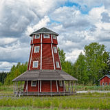 Red-ochre painted wooden tower Royalty Free Stock Photo