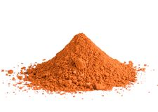 Red ochre pigment pile. A pile of red ochre powdered pigment isolated on a white background stock photography