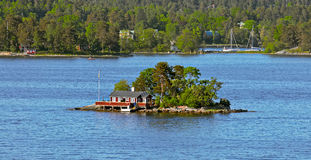 Free Red Ochre Wooden Cabin On Island Stock Photos - 67868133