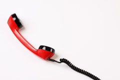Red off-hook telephone receiver Royalty Free Stock Image
