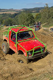 Red off road car in the deep mud. Vertically. Royalty Free Stock Photography