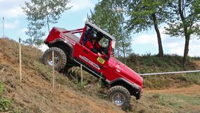 Red off road car is speeding slope stock video footage