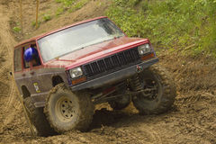 Red off-road car in terrain. Stock Image