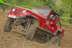 Red off-road car on top of a steep hill Stock Photo