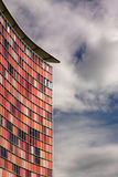 Red-office. Modern office building against cloudy sky Stock Image