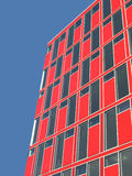 Red office building. Red façade of a office building with much windows Stock Image