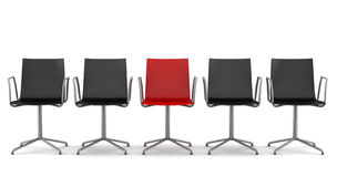 Red office chair among black chairs isolated Royalty Free Stock Photo