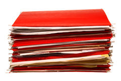 Red Office File Folders Stack with Papers Isolated. Stack of red hanging office file folders filled with old papers isolated on white Royalty Free Stock Images