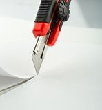 Red office knife isolated on white Royalty Free Stock Images