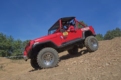 Red offroad car Stock Images