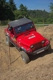 Red offroad car on the trial race Royalty Free Stock Photo