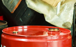 Red oil barrels in mechanic garage car service or shop Royalty Free Stock Photography