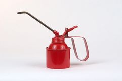 Red oil can. Antique red oil can photographed on a white background Stock Photo
