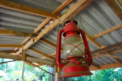 Red oil lamp on roof beam Stock Image