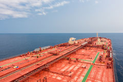 Red oil tanker. Crude oil tanker steaming to skyline Stock Photography