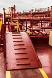 Red oil tanker ladder. Crude oil tanker deck during loading Royalty Free Stock Image