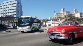 Red Cuban Car on the road in Malecon Havana stock video footage