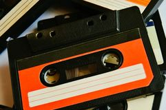 Red old audio cassette background. 80s-90s. Close-up. Red old audio cassette background. 80s-90s stock image