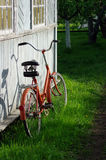 Red old bicycle near old wooden wall Stock Photo
