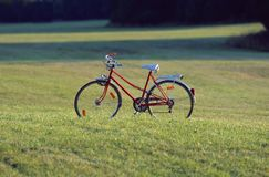 Red old bicycle with a retro effect Royalty Free Stock Photo