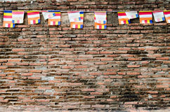 Red old Brick Wall with Colorful Flags Stock Photo