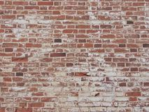 Red old brick wall. Old red brick wall with peeling white paint, brick texture Stock Photography