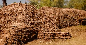 An old bricks made protection wall of a place. Red old bricks made protection wall of an ancient place in Bangladesh unique stock photo stock images