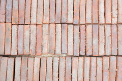Red old bricks stacked in piles Stock Images