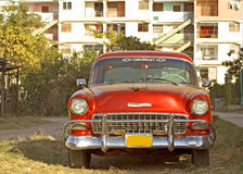 Red old car in the city of habana, cuba.