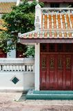 Red old carved wooden Chinese folding door of Wat Ratchaorotsaram Bangkok stock photos