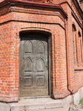 Red old church door, Lithuania Stock Image