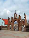 Red old church gate, Lithuania Stock Photos
