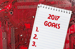 Red old dirty computer circuit board and 2017 goals text concept. Red old dirty computer circuit board Royalty Free Stock Images