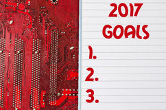 Red old dirty computer circuit board and 2017 goals text concept. Red old dirty computer circuit board Royalty Free Stock Photo