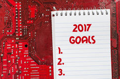 Red old dirty computer circuit board and 2017 goals text concept. Red old dirty computer circuit board Stock Photo