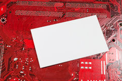 Red old dirty computer circuit board and place for text Stock Photo